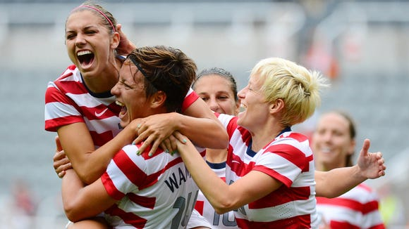 Alex Morgan, left, hugs Abby Wambach after a goal in the 2012 Olympics, which the Americans won.