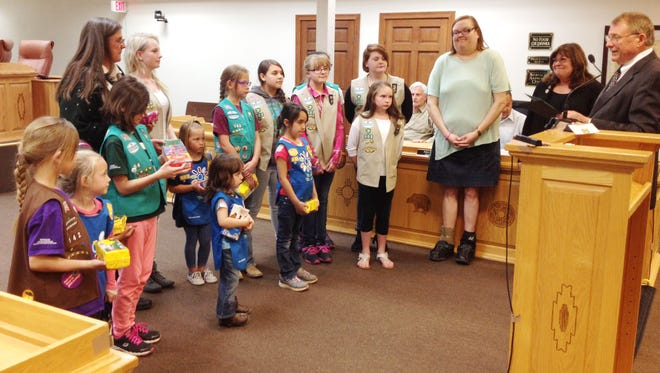 Mayor Ken Ladner, at right, reads a proclamation declaring March 6 to March 12 as Girl Scout Week in Silver City during Tuesday's Town Council meeting.