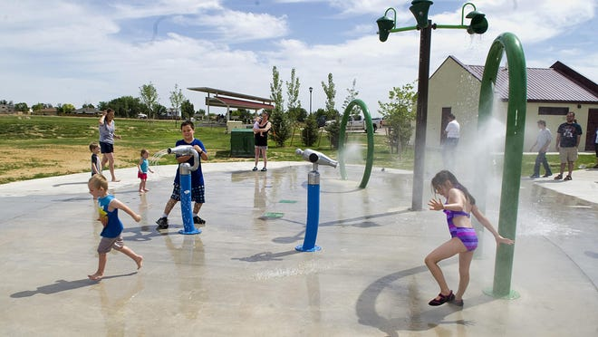 Children play in the Pueblo West Civic Center Park splash park after it was dedicated in 2014. Civic Center Park was the first park built in Pueblo West since 1972. The splash pad is now open.