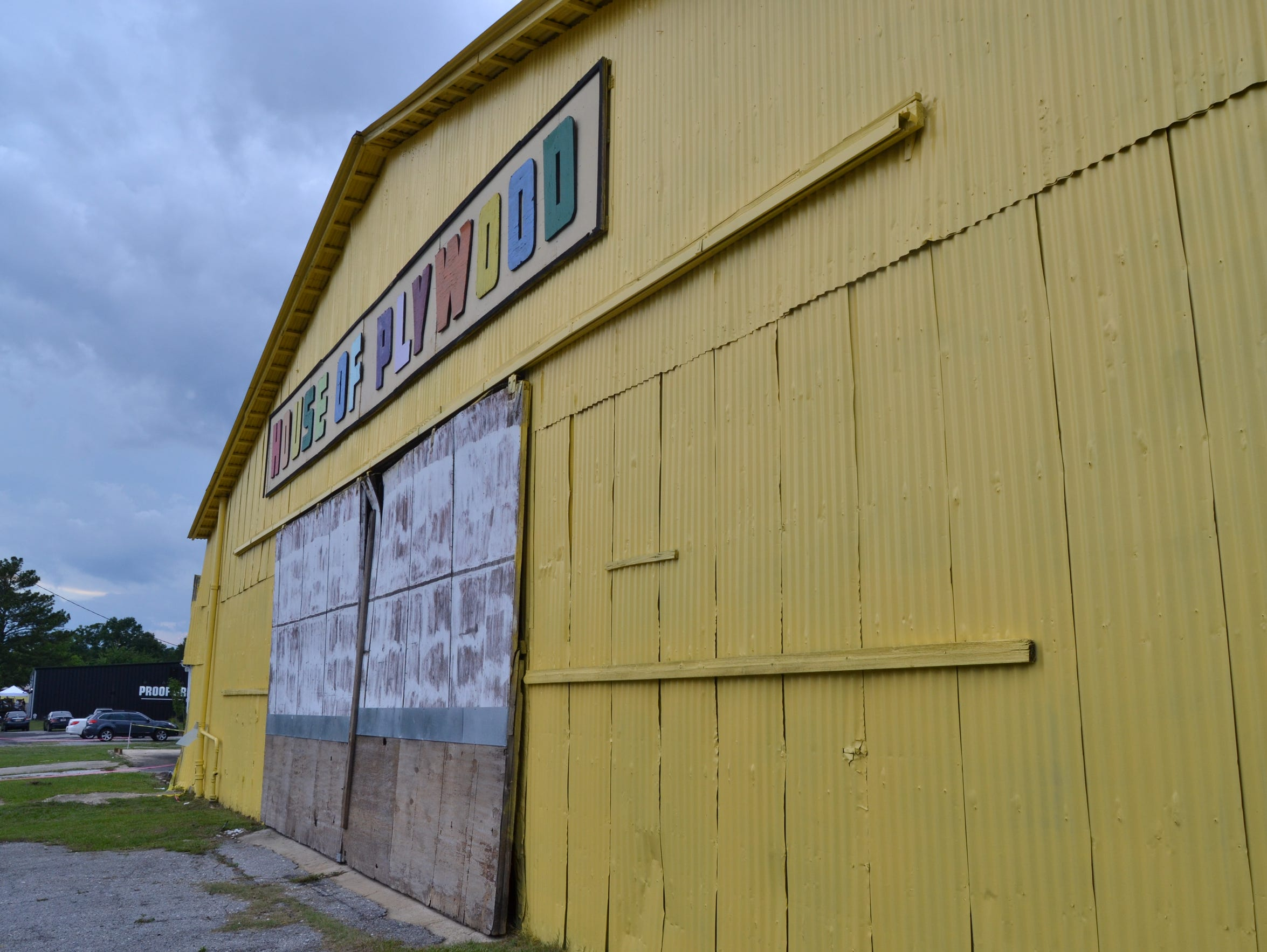 Fresh yellow paint adorns a warehouse in Railroad Square.