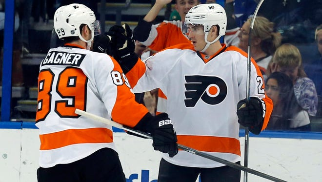 The Flyers' Matt Read, right, celebrates his goal with teammate Sam Gagner during the second period of Friday's game against the Tampa Bay Lightning.