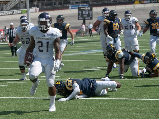 Detrez Newsome (21) needs 140 yards to clinch his second