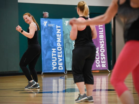 Instructor Laurie Determan leads a Zumba class Friday,