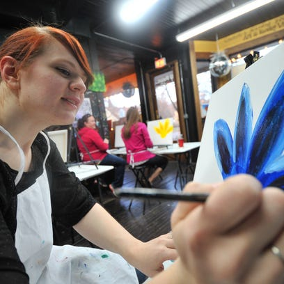 Owner Briana Ziebell, right, works with Kimberly Duberstein on her art during a painting class Wednesday at U Paint & Party in Wausau.