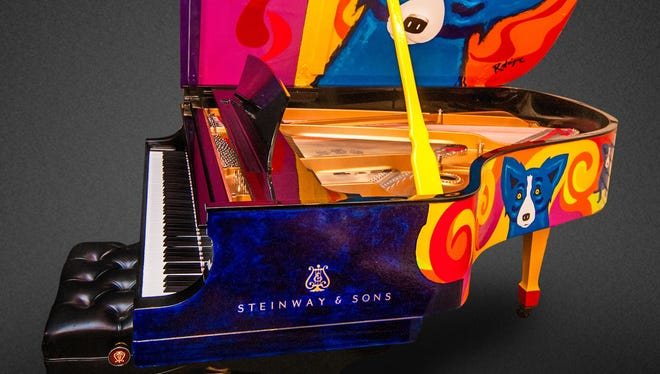 The Rodrigue Steinway is on display in the lobby of the SHeraton New Orleans hotel.