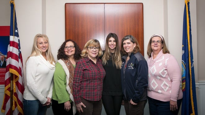 Rochelle Sulli, left, Maryanne Zani, Dory Braun, Woodhouse General Manager Nicole Starr,  Deanna Fuller and Angela Uhnavy.