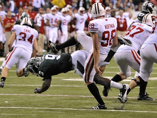 MSU's Isaiah Lewis makes contact with Wisconsin punter Brad Nortman after trying to block a punt in the final minutes of the 2011 Big Ten Championship Game.