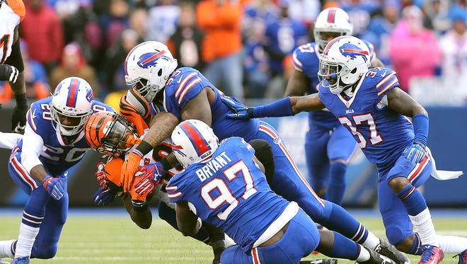 Bengals RB Jeremy Hill is brought down by the Buffalo defense last Sunday.