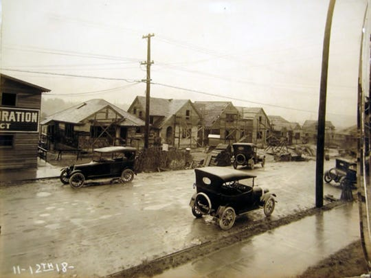 Early 20th century cars park along Pacific Avenue in Bremerton in 1918. The nearby homes under construction were part of an experiment by the U.S. Housing Corporation. Nearly 300 homes in Bremerton were built. The corporation, part of the Department of Labor, built around 170,000 units across the country.