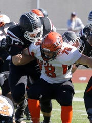 Elmira lineman Dan Fedor blocks a Union-Endicott player