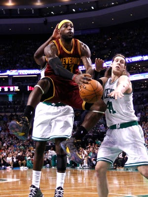 Cleveland Cavaliers forward LeBron James (23) shoots the ball against Boston Celtics center Kelly Olynyk (41) during the first half at TD Garden.