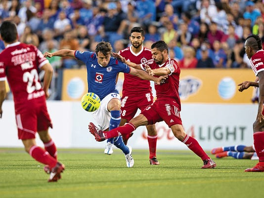 Jose Antonio Maduena (14) of Cruz Azul tries to get around defender ose Antonio Maduna (14) of Club Tijuana Xolos in the first half against at Sun Bowl Stadium, Wednesday, July 8, 2015, in El Paso, Texas. Photo by Ivan Pierre Aguirre for the El Paso Times