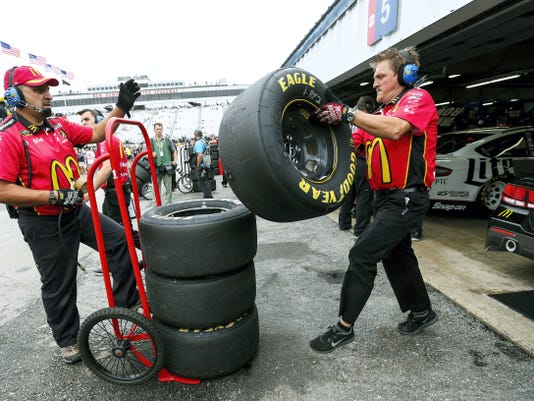 Diver Jamie McMurray's crew handles spent tires removed from his car during practice for today's NASCAR Sprint Cup series auto race at New Hampshire Motor Speedway, in Loudon, N.H. on Saturday