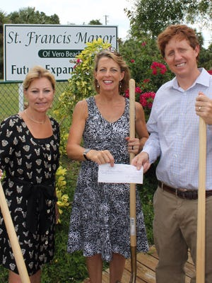 Jennifer Jones, executive director of the John's Island Foundation, presenting a check for $70,000 to Maria Elena Kitchell and Louis Schacht, co-chairs of the St. Francis Manor capital campaign.