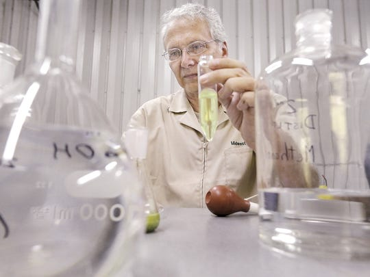 Chemist Rick Cole works with a solution containing hops in a centrifuge tube in his Evansville laboratory called Midwest Hop and Beer Analysis LLC.