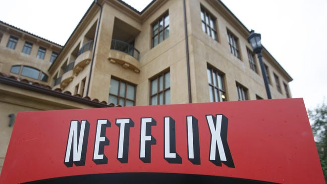 """This Jan. 29, 2010, file photo shows the company logo and view of Netflix headquarters in Los Gatos, Calif. Netflix's normally lighthearted Twitter account took on a more somber tone on Saturday: """"To be silent is to be complicit. Black lives matter. We have a platform, and we have a duty to our Black members, employees, creators and talent to speak up."""""""