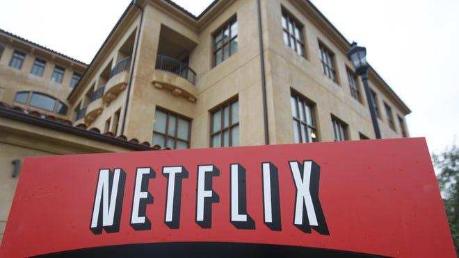 "The company logo and view of Netflix headquarters are seen in Los Gatos, California. Netflix's normally lighthearted Twitter account took on a more somber tone on May 30: ""To be silent is to be complicit. Black lives matter. We have a platform, and we have a duty to our Black members, employees, creators and talent to speak up."""