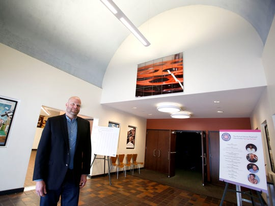 Clayton Bushong, director of programming at The Picture House Regional Film Center in Pelham, is photographed in the lobby May 6, 2016. The theater underwent a million dollar renovation and are one of three that has expressed interest in the Larchmont movie theater building that is up for sale for $1.5 million. The building is for sale, the movie theater is a tenant whose lease expires in September.