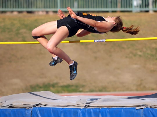 Palm Desert's Seline Schinke clears the high jump bar during a Desert Valley League track meet between Palm Desert and La Quinta high schools on Tuesday, April 26, 2016, in La Quinta, Calif.