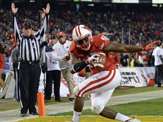 Dec 30, 2015; San Diego, CA, USA; Wisconsin Badgers tight end Austin Traylor (46) celebrates after scoring a touchdown against the USC Trojans during the third quarter in the 2015 Holiday Bowl at Qualcomm Stadium. Mandatory Credit: Jake Roth-USA TODAY Sports