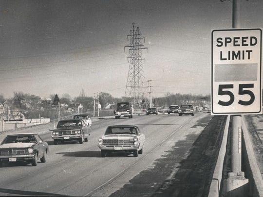 Drivers pass a reflecting Wisconsin's new 55 mph limit on eastbound I-94 east of Elm Grove Road in this December 1973 photo.