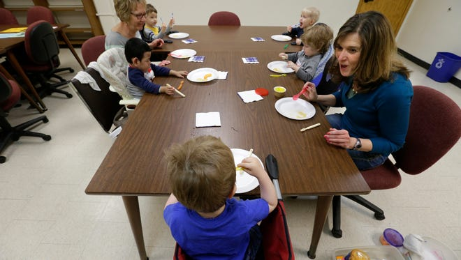 Sharon VanStiphout, upper left, and Jenifer Krzanowski , right, help children with significant feeding aversions during the Early Intervention Feeding Group on March 31 at the Community Early Learning Center in Appleton. VanStiphout is a certified occupational therapy assistant and Krzanowski is a certified occupational therapist. The two present the children with a variety of food and textures so that they can explore it and have a chance to tolerate it on their plate.