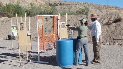"""Pam Pitcher defends the Mesquite Shooters Pistol Range from the """"marauding zombies."""""""