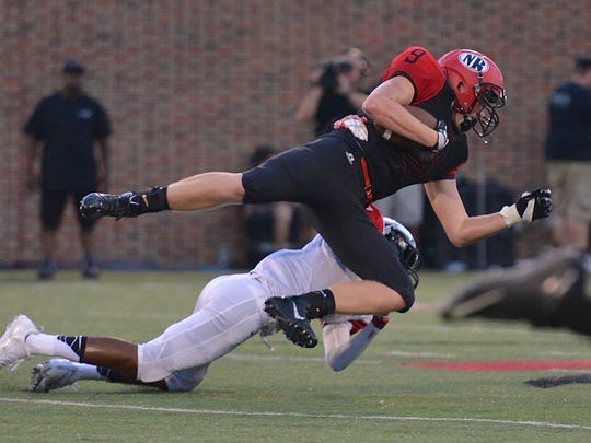 Gage Kramer is tackled by an Indian Hill defender.