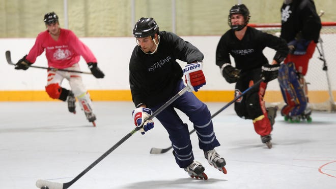Team Brick Haus Pizza takes on team The Standard on College in the Wednesday Night Draft League of roller hockey at the Tallahassee Indoor Sports facility.