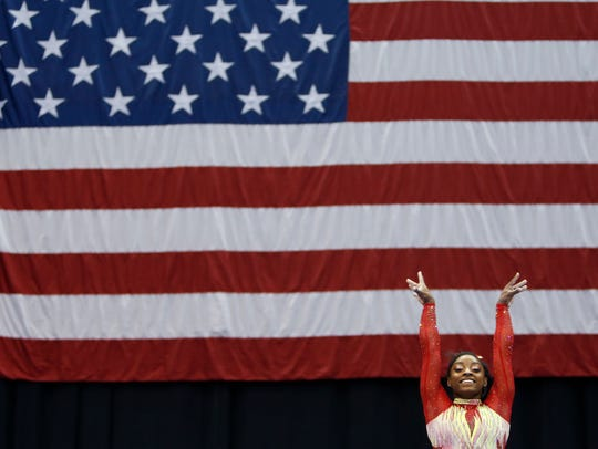 Olympic champion Simone Biles starts her routine on