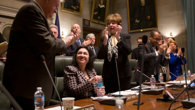 Betty Rosa, seated, is applauded after bing elected chancellor of the New York Board of Regents during a meeting on Monday, March 21, 2016, in Albany, N.Y. Rosa, a former superintendent from the Bronx, replaces Merryl Tisch, who's stepping down from the board after 20 years, the last seven as its leader. (AP Photo/Mike Groll)