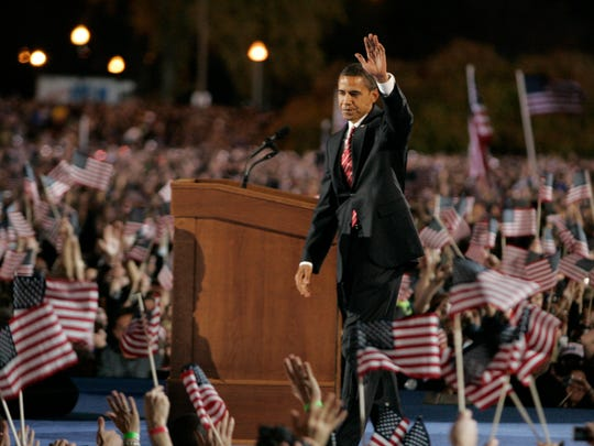 Barack Obama greets the crowd in Chicago's Grant Park