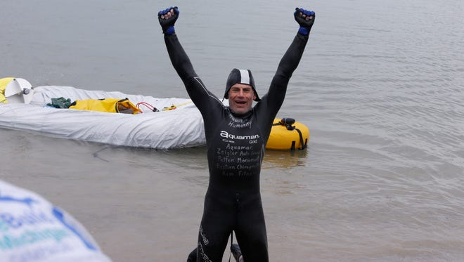 Jim Dreyer, a long-distance swimmer, arrives at Belle Isle in Detroit, Wednesday.