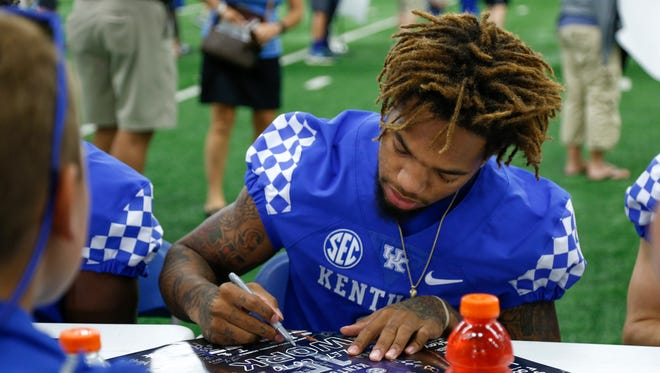 UK wide receiver Lynn Bowden signs a poster for a fan during UK Football Fan Day in Lexington, Ky., on Saturday, August 5, 2017.