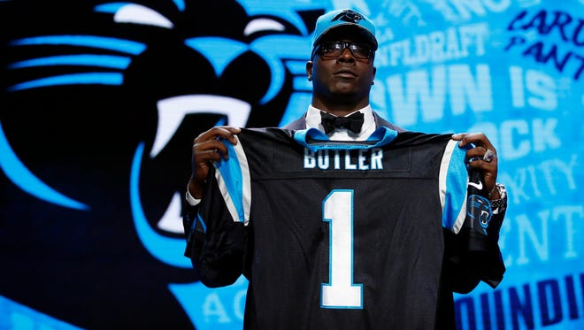 Louisiana Tech's Vernon Butler holds up a jersey after being selected by the Carolina Panthers as the number thirty overall pick in the first round of the 2016 NFL Draft at Auditorium Theatre.