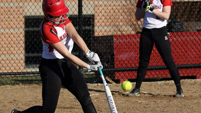 Taylor Oliver gets a hit during a game against Germantown at Arrowhead High School Tuesday, March 28, 2017.