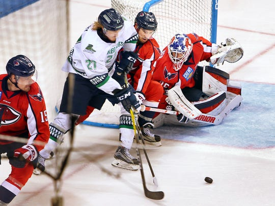 Everblades Matt Berry tries to get the puck past the Stingrays' Steve Weinstein and goalie Parker Milner as the South Carolina Stingrays defeated the Florida Everblades 2-1 to win the South Division Kelly Cup best-of-seven series 4-1 Thursday, May 3, 2017 at the North Charleston Coliseum.