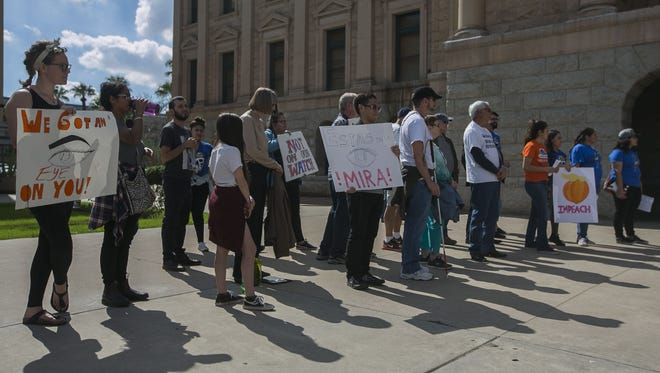 About 40 people gathered at the Arizona Capitol in Phoenix to protest the Arizona Legislature's agenda on voting issues, immigration and public education.