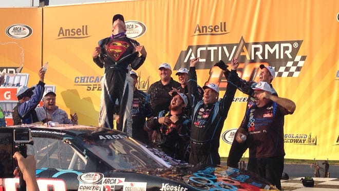 Mason Mitchell reveals the Superman logo underneath his racing suit after winning the ARCA Series race at Chicagoland Speedway on Saturday.