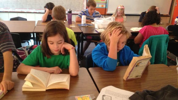 Students at Lowe Elementary School read during class.