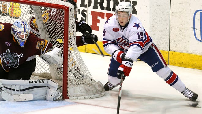 Amerks left winger Luke Adam curled out from behind the net but his shot ended up hitting the far post behind Wolves goalie Jake Allen in Game 1.