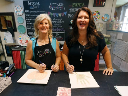 Firehouse Pottery owner Amie VanDamme, right,  and