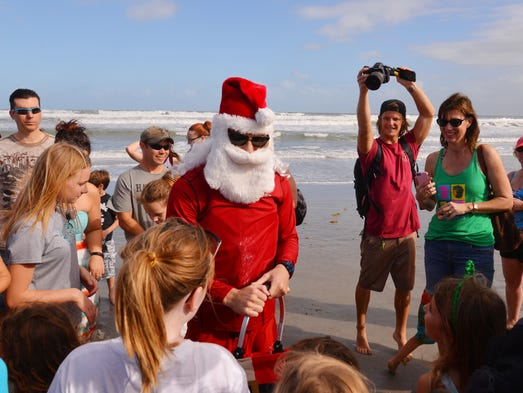 At 2:00 p.m. Friday after noon, Surfing Santa arrived