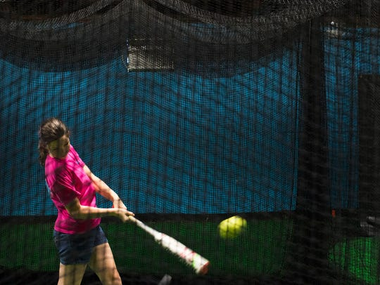 Riley Ahrens, 12, practices at Batter's Alley Wednesday,