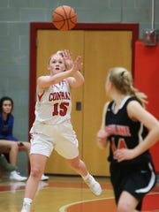 Conrad's Jordan Rook (15) launches a long pass in her team's 73-62 win over Ursuline on Feb. 2. The second-ranked Red Wolves are 15-2 this season.