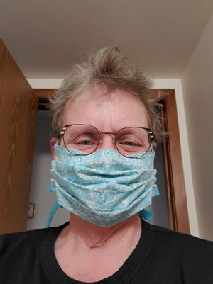 Sister Gretchen Webb, IHM, and one of the face masks she has made.