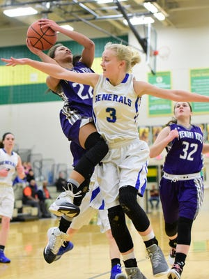 Jazmin Bulger of Fremont Ross draws contact on her way to the bucket Wednesday.