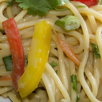 A bowl of Asian peanut noodle salad from VKA Kitchen