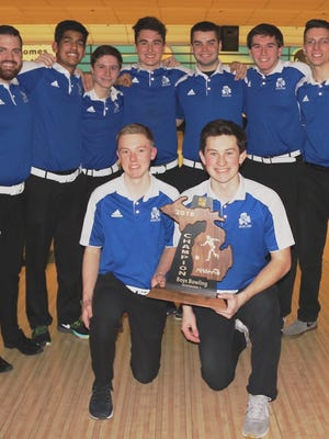 Members of the Catholic Central Region 5 championship bowling team included (front row, from left) senior co-captains Andrew Lack and Jacob Smith; (back row, from left) head coach Matt Nugent, Chintan Maheshwari, Nick Zappia, Jaden Thomas, Matt Skarnulis, Ben Ward and assistant coach Scott Kujawa.