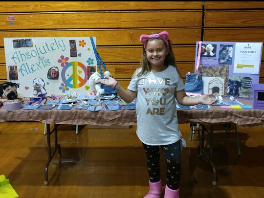 Alexis Martz, 10, makes purses from old denim blue